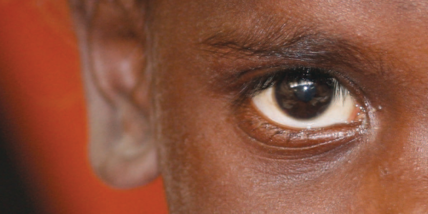 Indigenous boy eye and ear close up