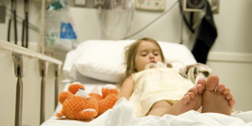 Girl in hospital bed