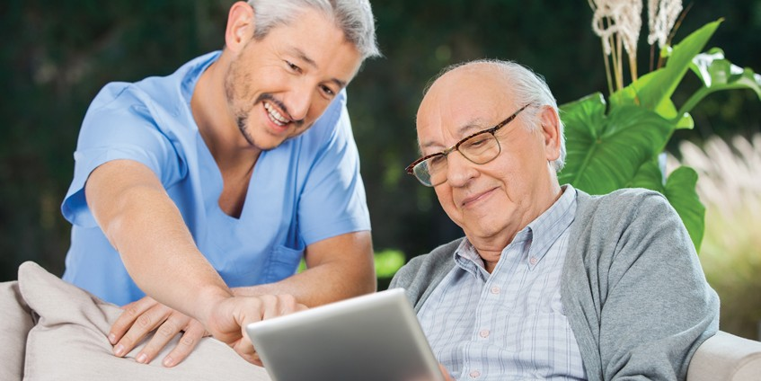 Two men looking at tablet screen