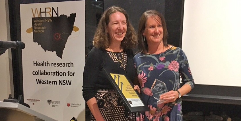 Catherine Bourke receiving the 2018 Emerging Researcher of the Year award at the WHRN Conference