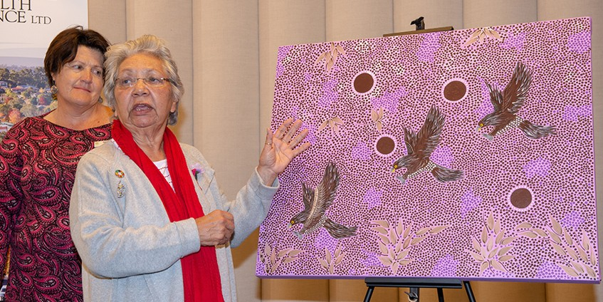 Matilda House presents her Reconciliation Action Plan artwork to Chair of the Alliance RAP Working Group, Geri Malone
