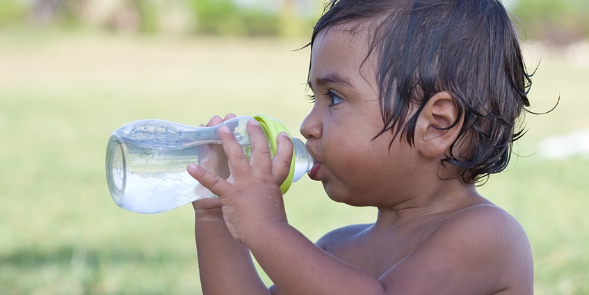 Young child drinking water