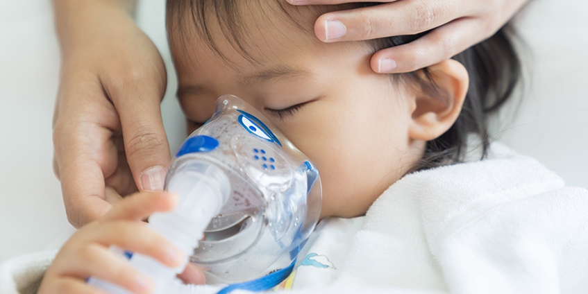 infant using a breathing mask
