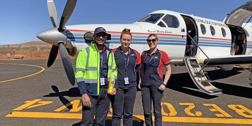 (L-R) Senior Dentist Vaibhav Garg, Dental Assistant Nicole Hearps and Program Co-ordinator Kelly Fargher arriving in Kintore, NT for a week-long clinical trip