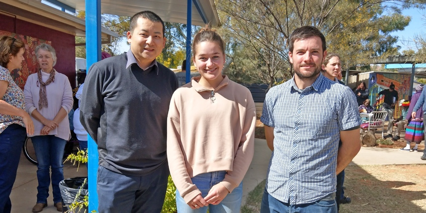 Emma Buttolph with pharmacists Danny Tsai (l) and Tobias Spears (r) at Purple House