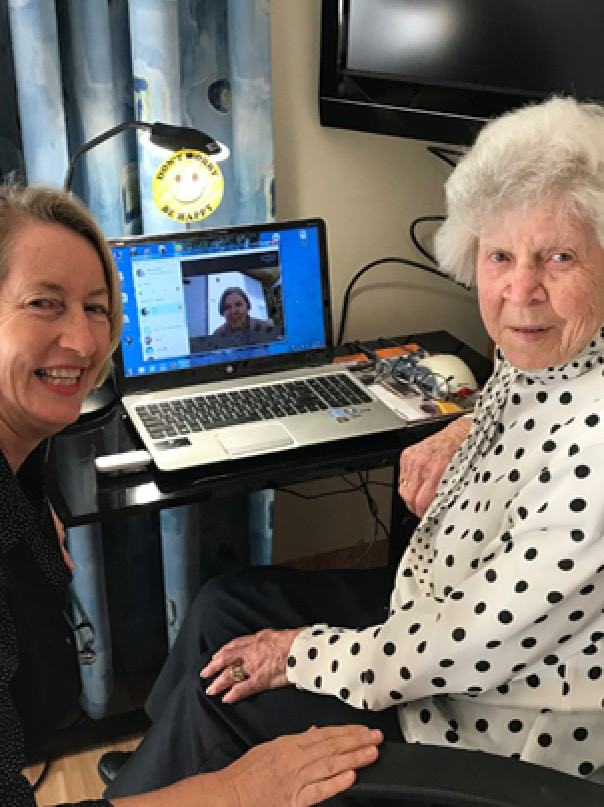 younger and older women in front of computer