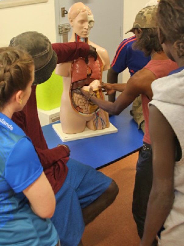 High school students reassemble Gutso the medical mannequin