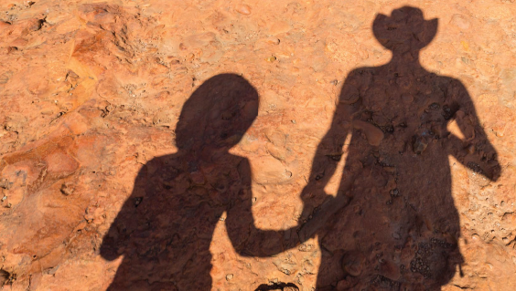Silhouettes on red earth