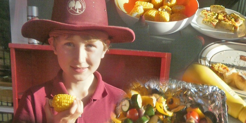 A Lower Hume primary school student enjoys barbequed vegetables