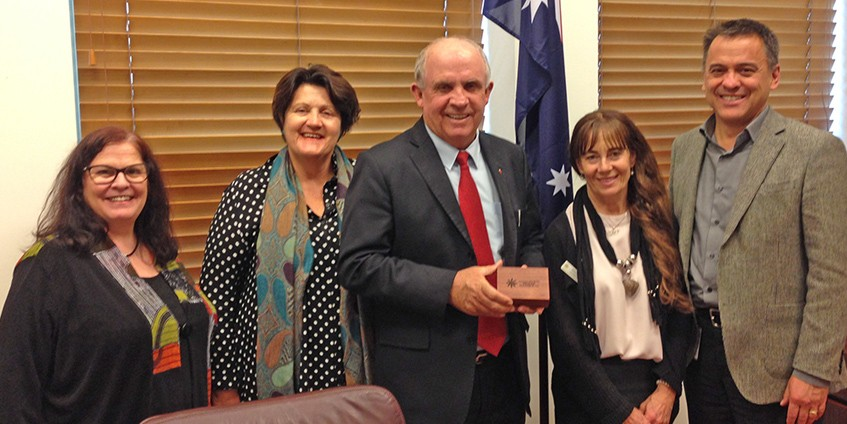 Senator John Williams is presented with a farewell gift from Alliance delegation (L to R) Dorothy Coombe, Geri Malone, Janine Snowie and Chris Bourke. Photo NRHA