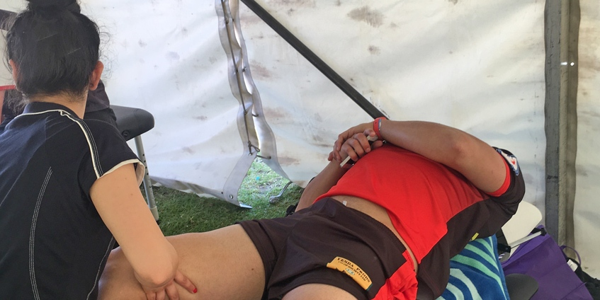 RMIT student helping a patient at the NSW Koori Knockout in Leichhardt 2017
