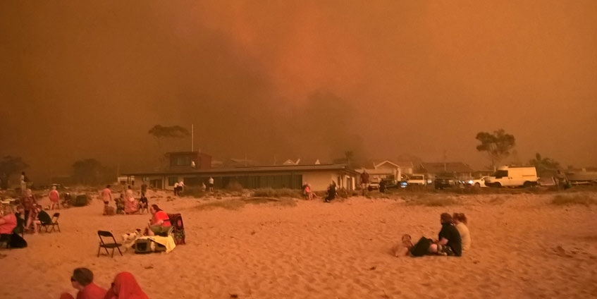 Malua bay on the beach during a bushfire
