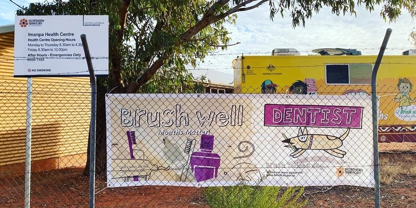 Brush well banner in front of dental truck