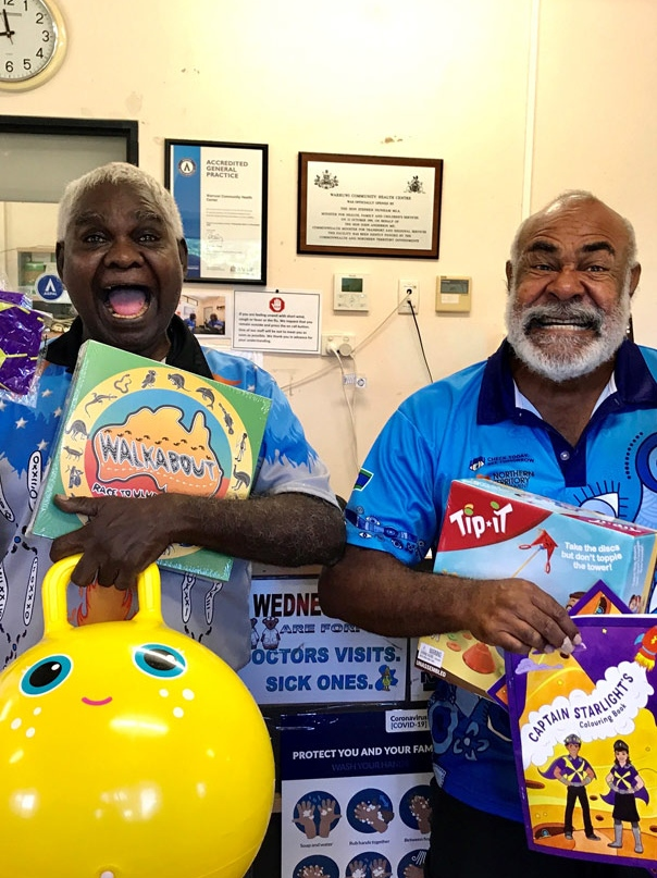 Douglas and Eda at the Warruwi Clinic, NT, receiving their Starlight goodies pack