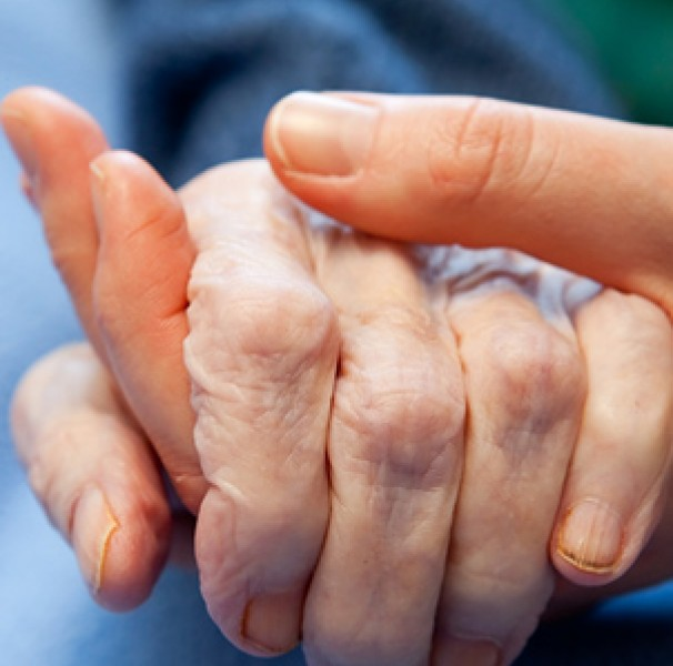 Older hand being held